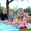 Oliver Pategas and his friends Brooke and Rylan Kennedy shared a blanket Wednesday, enjoying their front row seat to see Vanessa Trien and the Jumping Monkeys.   (Bobowick photo)