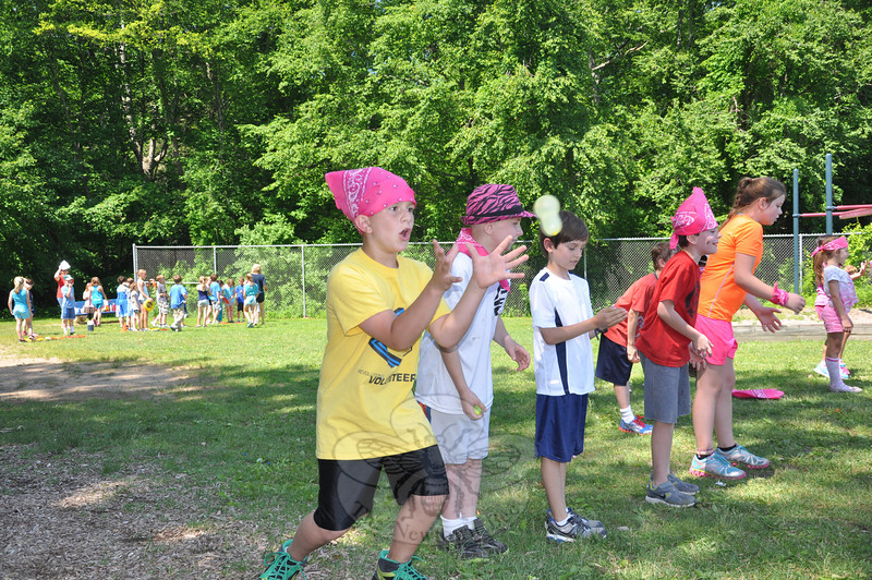 Student Arri Nichols concentrated before one catch during the water balloon toss during Middle Gate School's annual Field Day on Monday, June 17.   (Dietter photo)