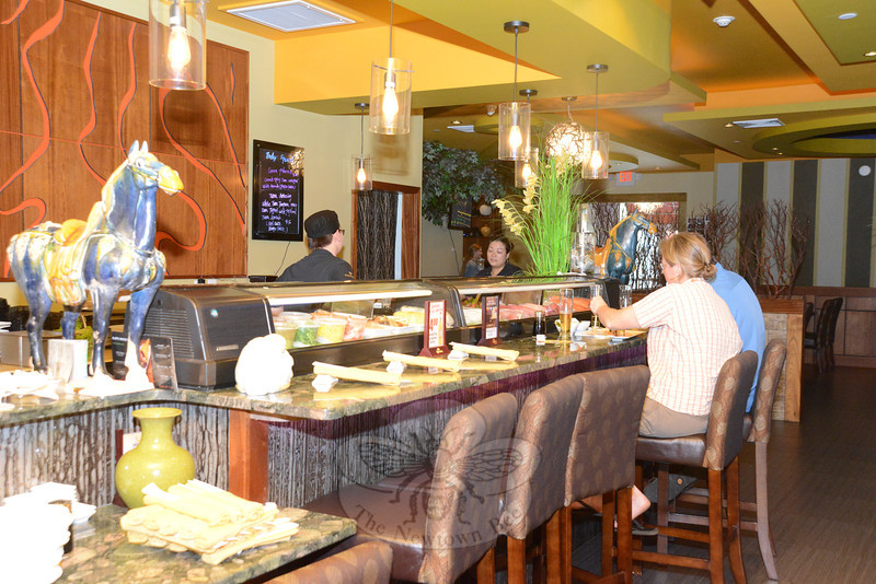 Guests seated at the sushi bar can choose from a selection of fresh foods prepared in front of them.  (Bobowick photo)