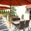 Dine outdoors on the Fusion 25 patio where umbrellas shade individual tables.  (Bobowick photo)