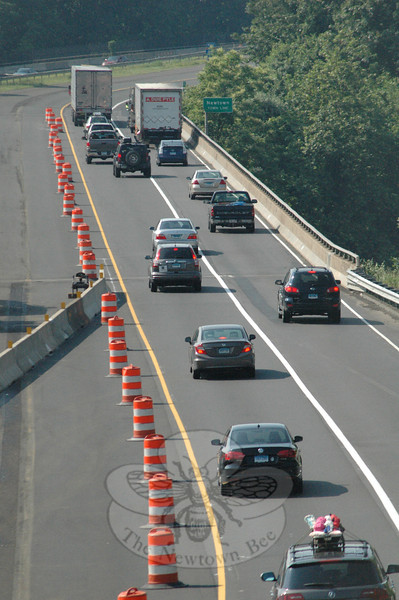 As seen on Tuesday, June 25, westbound traffic on Interstate 84 crosses above Lake Zoar on Rochambeau Bridge. At left, traffic barrels and concrete barrier rails are positioned to shift the travel lanes on the bridge to the right as part of the nearby Center Street bridge recon-struction project. The two Center Street bridges are about 1,000 feet west of Rochambeau Bridge.  (Gorosko photo)