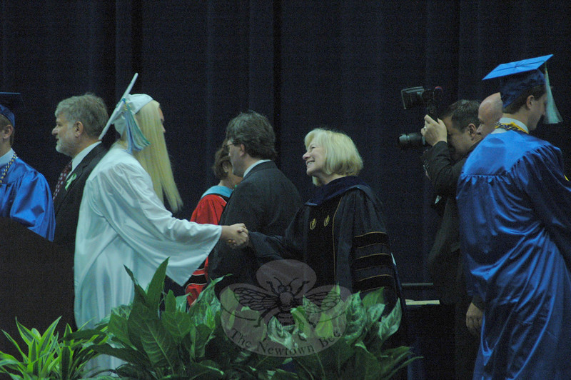 "Departing Superintendent of Schools Janet Robinson, center, shook the hand of a graduate during commencement exercises on Saturday, June 22.  (Hallabeck photo)<br /> <br /> PLEASE NOTE: Additional photos from this event, which were presented online in a slideshow, can be viewed here:<br />  <a href=""http://photos.newtownbee.com/Journalism/Special-Events/Newtown-High-School-Class-of/30241881_rDjLT8#!i=2603084990&k=22SXVwZ"">http://photos.newtownbee.com/Journalism/Special-Events/Newtown-High-School-Class-of/30241881_rDjLT8#!i=2603084990&k=22SXVwZ</a>"