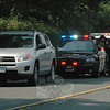 Newtown police joined forces with police from Redding, Bethel, Brookfield, and Ridgefield during the past week to enforce distracted driving laws, including laws concerning the use of handheld cellphones and texting devices. In the photo, a Bethel police officer, standing, confers with a Redding officer who had stopped a motorist on South Main Street on Monday afternoon. Penalties for violations range from $125 to $400 fines, depending upon a given driver's violation history.  (Gorosko photo)