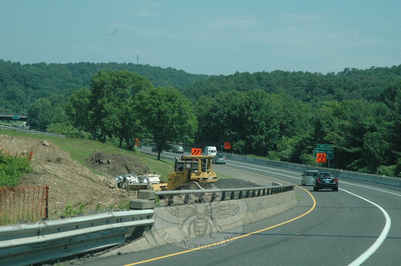 As viewed on Monday, June 24, eastbound Interstate 84 is shown in the area where it crosses above Center Street in the Riverside section of Sandy Hook. Parked on the median is a piece of the earthmoving equipment being used in the project to reconstruct both the eastbound and westbound I-84 bridges above Center Street.   (Gorosko photo)