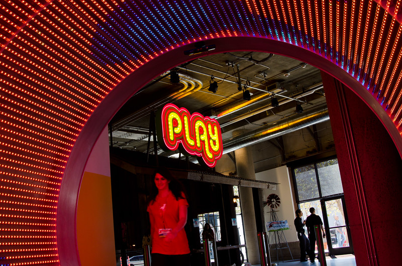 A company employee walks through the multimedia tunnel at the entrance of Zynga's corporate HQ in San Francisco