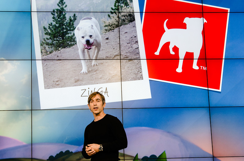 """That's where the name comes from: Zinga, the late, beloved dog of Zynga founder Mark Pincus, shows up on a screen at the """"Zynga Unleashed"""" (pun intended?) press event"""