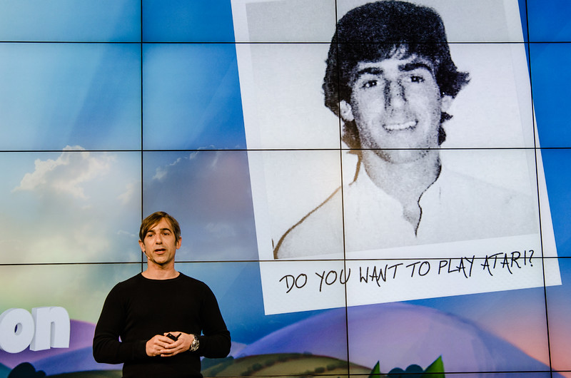 """""""Do you want to play Atari?"""" Zynga founder Mark Pincus and his former, more youthful self at a press event"""