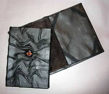 "Leather ""eye"" covers for e-readers and mini ipads"