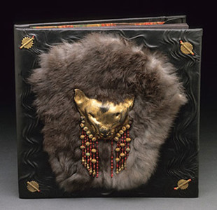 Post bound Scrap book with ceramic lion mask and fur on front