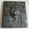 Large leather journal with sculpted face