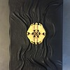 Sculpted leather journal cover with carved bone medallion