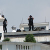 I see you!  Military personnel who are permanently posted on top of the White House.