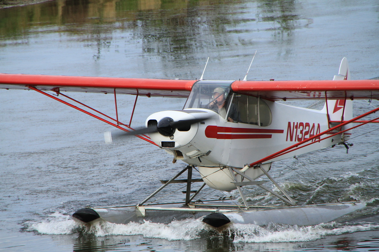 """On board we listened to a conversation from the pilot, explaining various """"bush planes"""" used for transportation in Alaska."""