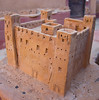 Clay model of a kasba with four corner towers; it would have housed an extended family.