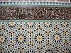 Zellij tiles below a row of cursive Arabic.