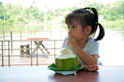 PF enjoying the complimentary coconut