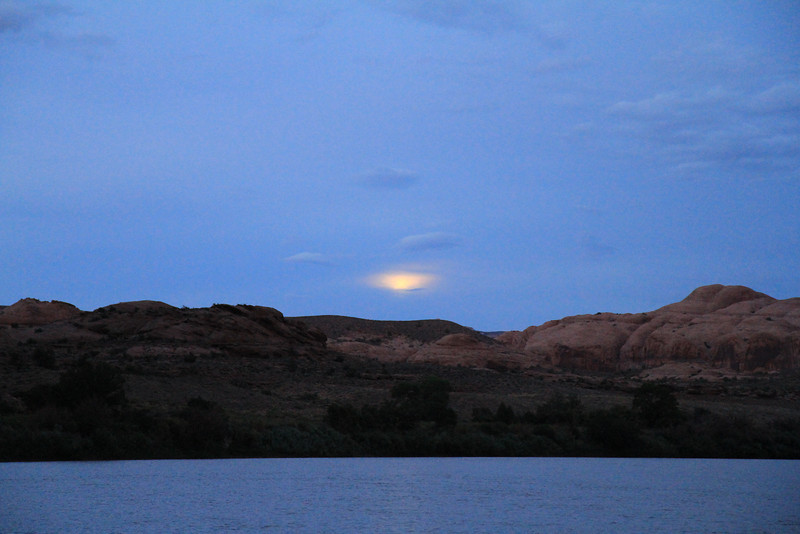 Full moon trying to peak thru the clouds over the Colorado River.