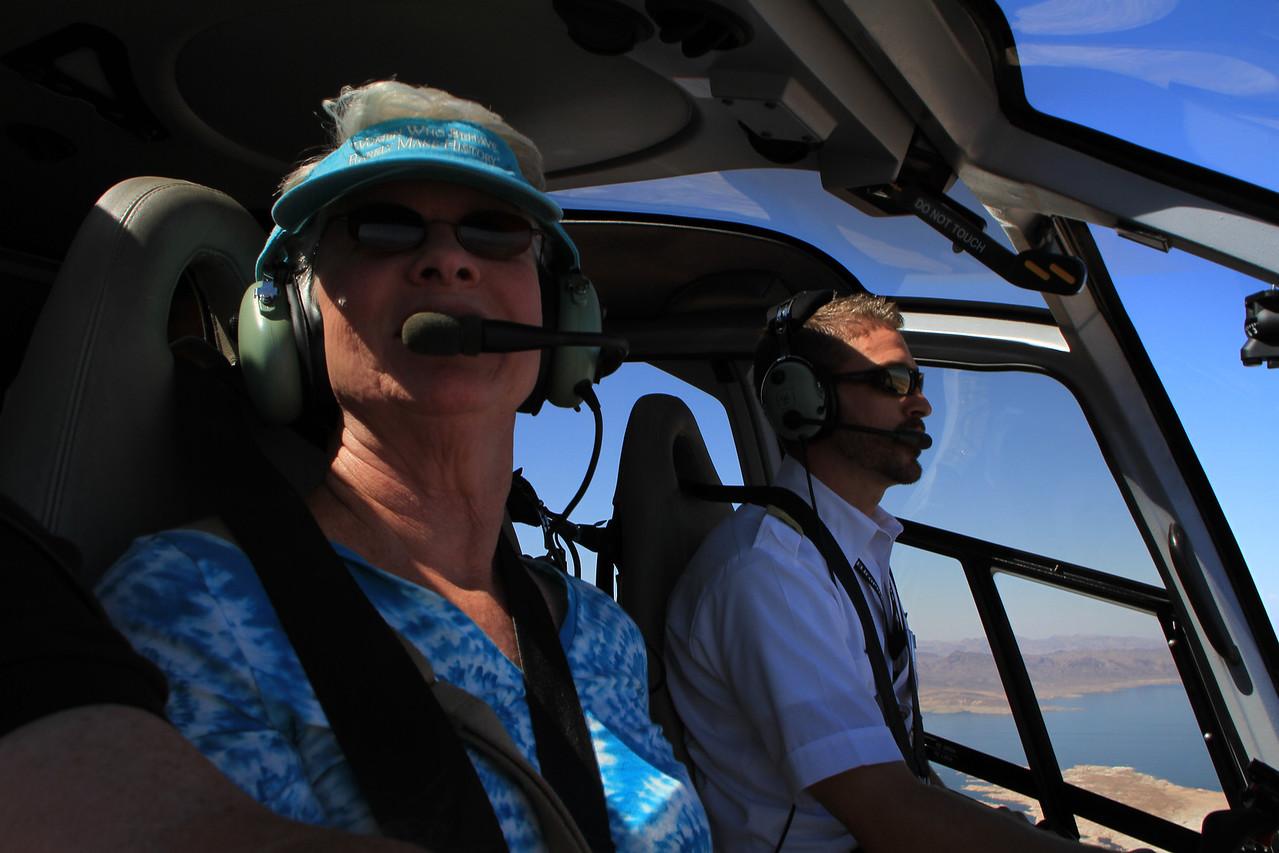 Lynda next to the pilot, enjoying the flight, front row seating :)