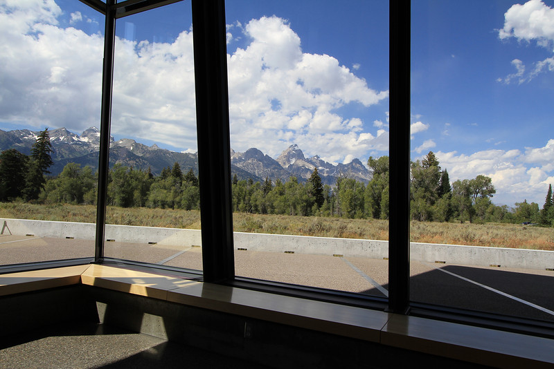 This shot is from one of the Park's Visitor Centers.  The silver lines outside the windows  are a continuation of lines inside indicating each of the Teton Peaks and their height.