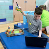 Campers from Fitchburg Public Schools' Camp S.U.N. celebrated the end of camp with a day of project demonstrations and skits Thursday, July 27, 2017. Felix Gomez Jr. programs his lego Wedo 2.0 helicopter to pick things up during the project demonstration portion of the last day of camp. SENTINEL & ENTRPRISE/JOHN LOVE