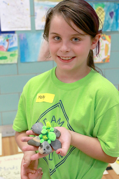 """Campers from Fitchburg Public Schools' Camp S.U.N. celebrated the end of camp with a day of project demonstrations and skits Thursday, July 27, 2017. Molly Sacramone, 9, shows off her trutle """"Flash"""" she made out of rocks on the last day of camp. SENTINEL & ENTRPRISE/JOHN LOVE"""