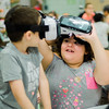 Talah Derwiche, 7, and Destiny Chamberlian, 7, use virtual reality goggles during the conclusion of the Fitchburg Public Schools' Journeys Summer Camp at Crocker Elementary School on Wednesday, July 26, 2017. SENTINEL & ENTERPRISE / Ashley Green