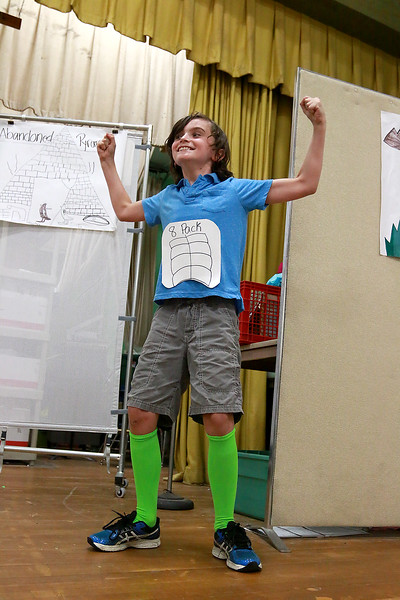 Campers from Fitchburg Public Schools' Camp S.U.N. celebrated the end of camp with a day of project demonstrations and skits Thursday, July 27, 2017. Playing Apollo during one of the skits is Jameson Mclinden, 9. SENTINEL & ENTRPRISE/JOHN LOVE