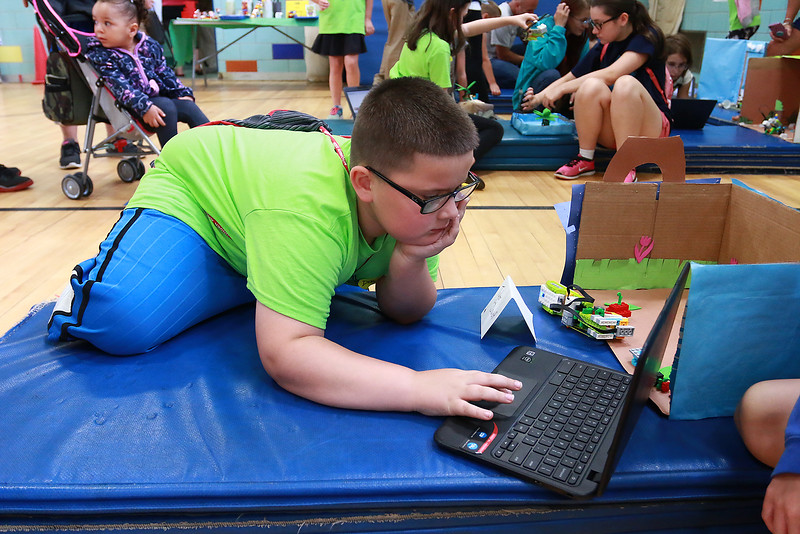 Campers from Fitchburg Public Schools' Camp S.U.N. celebrated the end of camp with a day of project demonstrations and skits Thursday, July 27, 2017. David Pitre, 10, tries to get his robot, he helped build, to move as he shows it off on the last day of the camp. SENTINEL & ENTRPRISE/JOHN LOVE