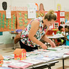 Kerry Tran looks over her childrens' work during the conclusion of the Fitchburg Public Schools' Journeys Summer Camp at Crocker Elementary School on Wednesday, July 26, 2017. SENTINEL & ENTERPRISE / Ashley Green