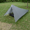"My shelter for the trip.  I have started using this instead of the tarp and bivy setup I've been using for quite a while now.  It is a Tarptent, ""Contrail"" model.  I have dubbed it the ""Fairy Tent"" as it is very much an ultralight shelter, a modern marvel of aluminum, sil-nylon, and spectra cordage.  It works very nicely, packs light and without taking up much space, and it seems to weather storms very nicely.  This particular evening a thunderstorm came through.  I stayed very dry in the tarptent, although a couple seams will need some sealing."