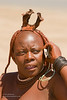 A Himba women using mobile 'phone, Windhoek, Namibia