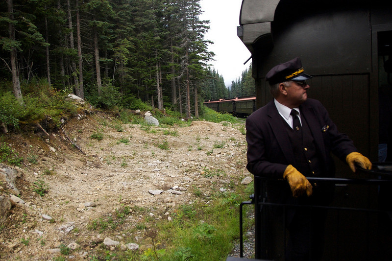 """The conductor getting ready to let us off at our """"train stop."""""""