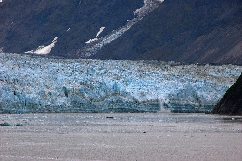 To the right of the photo, near the mountain that comes down to the sea, the glacier is calving ...