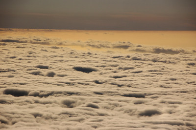 The flat blue above the clouds is the ocean in the distance.