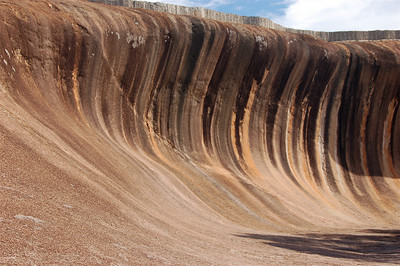 Wave Rock is one big hunk of granite shaped like--yes--a giant wave. The resemblance is made even stronger by the vertical streaks of algae. At the top of the rock is a retaining wall that allows rainwater (when they have any) to be collected in a dam.