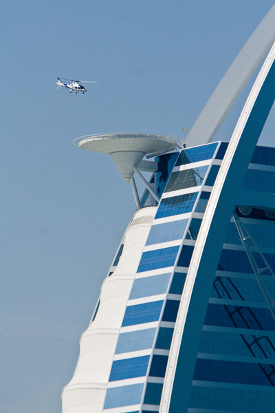 Helicopter taking off / landing from the helipad on the Burj Dubai, UAE