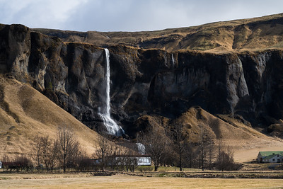 Waterfalls abound in Iceland. Foss á Síðu spectacularly drops over a farm along the Ring Road.