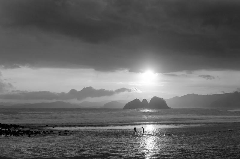 Two fisherman earning their livelihood in Air Guling