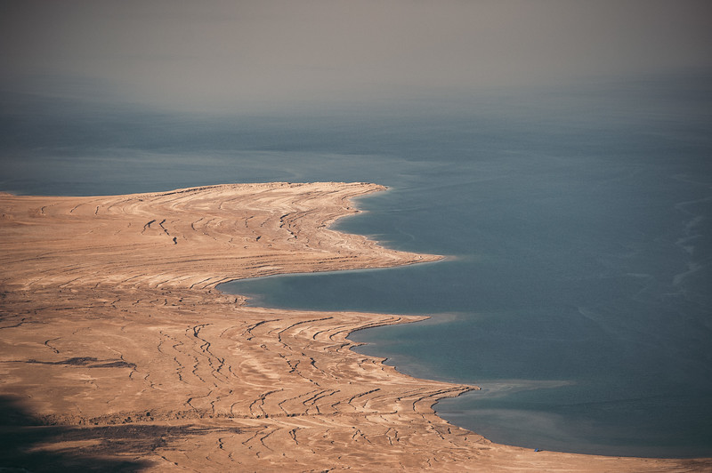 The dry coast line of the dead sea.