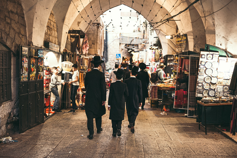 A jewish family on their way to the western wall, crossing the arabic part of the Old City in Jerusalem.