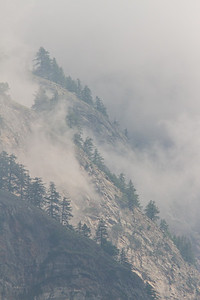 Mist rising from hillside, Valsavarenche, Italian Alps
