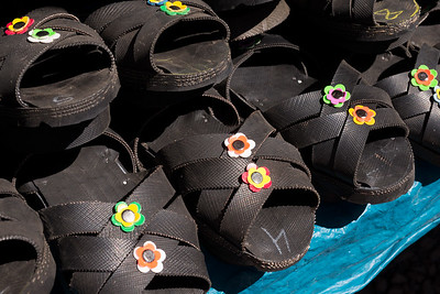 The locals wear sandals made from recycled car tires