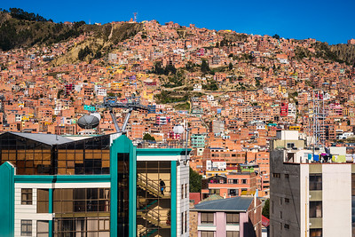 The numerous unadorned brick buildings result from Bolivian taxes, which are not due until completion of the structure