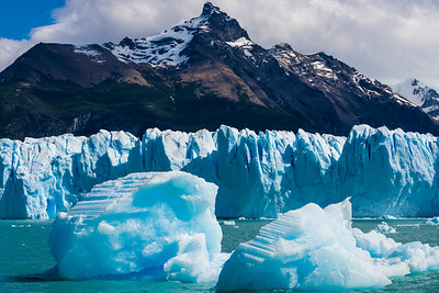 "That calving leads to icebergs floating in the waters made green by ""glacial milk"""