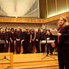 Meg Sommerfeld '90 introduces the choir and its director.