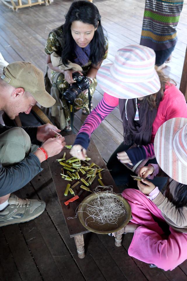 Learning how to weave lotus thread on Inle Lake, Burma (Myanmar).