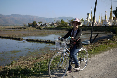Ana bikes around Nyaung Shwe, on Inle Lake, Burma (Myanmar).