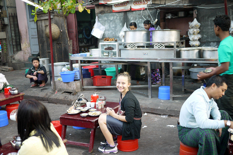 Ana smiles big at the thought of our delicious chapati and dhal from the street-food vendors in Mandalay.