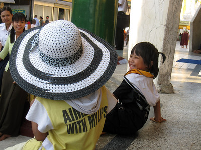 Two kids play around inside Shwedagon as their parents look on in Yangon, Myanmar (Burma)