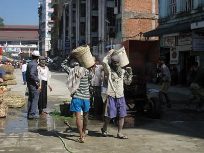 Burmese workers construct a new road in Yangon, Burma. in Yangon, Myanmar (Burma)